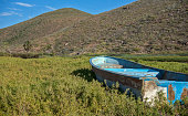 An Old Rowboat is Pulled off onto the Hillside and Left to Age Under the Sun in Todos Santos, Mexico