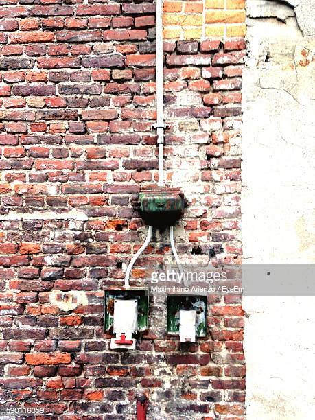 Abandoned Fuse Board On Brick Wall
