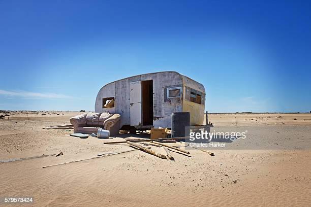 Abandoned Homeless Trailer in Desert Sand