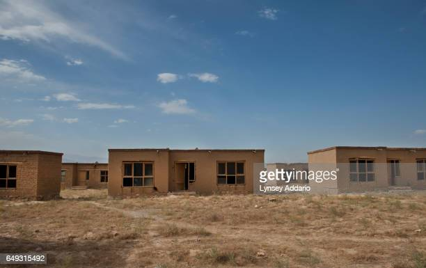 Abandoned homes are seen in the land allocation settlement of AliceGhan about 30 miles outside of Kabul Afghanistan July 22 2011