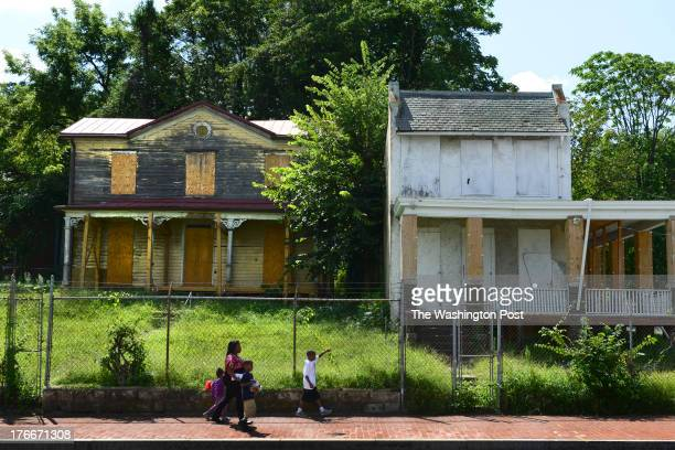 Abandoned house now boarded up on on Martin Luther King Blvd SE down a few blocks from the Anacostia Playhouse in Washington DC on August 5 2013 The...