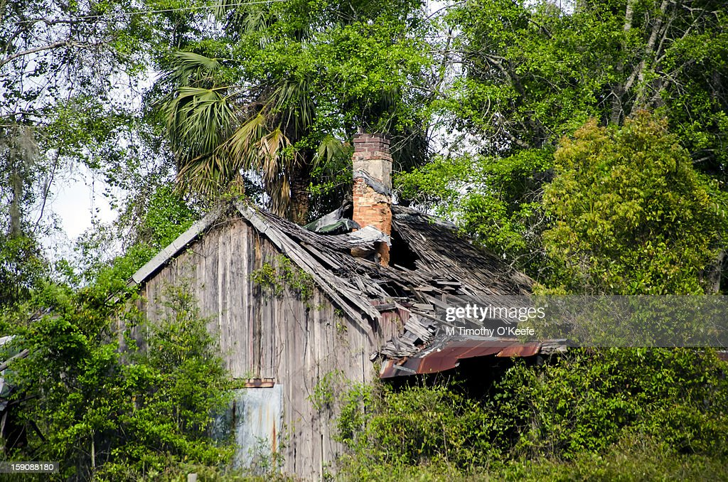 Abandoned house roof caving in : Stock Photo