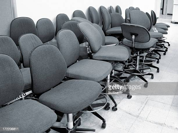 Abandoned office chairs in a closing industry