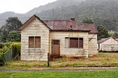 Old abandoned weatherboard home and shed in Queenstown, TasmaniaOld abandoned weatherboard home and shed in Queenstown, Tasmania