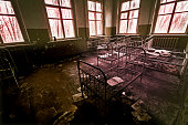 Abandoned psychiatric hospital with beds, fear and interior