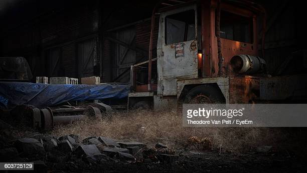 Abandoned Semi-Truck Against Factory