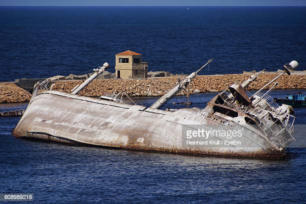 Abandoned Sinking Ship In Sea