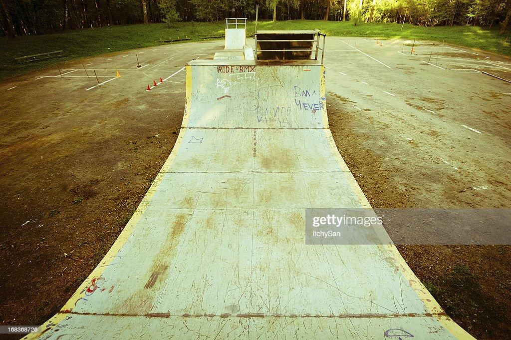 Abandoned skate park, rusty halfpipe