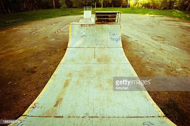 Abandoned skate park, rusty halfpipe