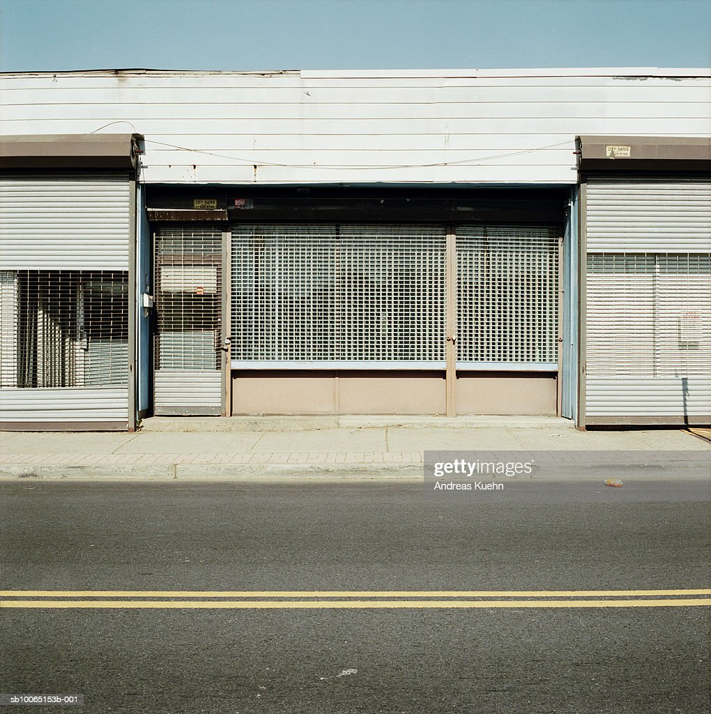 Abandoned store fronts boarded up : Stock Photo