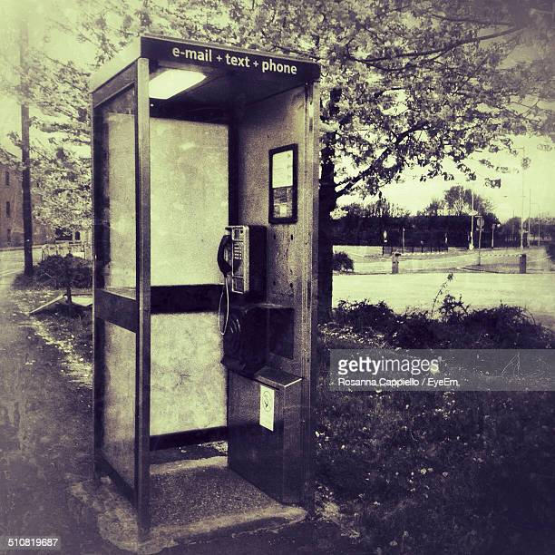 Abandoned telephone booth by road