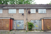 SALFORD, UK - JUNE 2013 - Abandoned terraced housing with metal shutters waiting for demolition in Salford, UK.