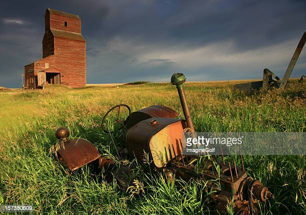 Abandoned Tractor and Grain Elevator on the Great Plains
