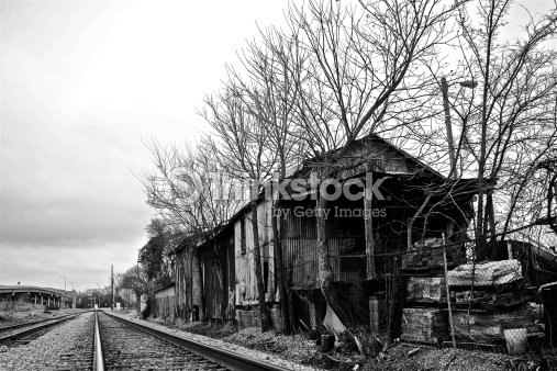 Abandoned Train Tracks And Building In Black White Stock