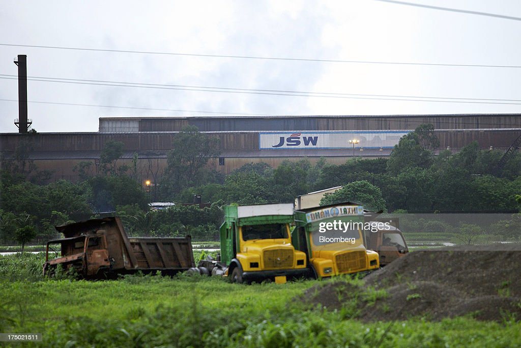 Abandoned trucks sit in front of the JSW Steel Ltd. manufacturing facility in Dolvi, Maharashtra, India, on Friday, July 27, 2013. JSW Steel is scheduled to announce first-quarter earnings on July 31. Photographer: Adeel Halim/Bloomberg via Getty Images