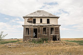 close up of an abandoned two story house