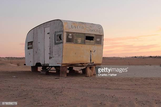 Abandoned vintage travel trailer in Sonora desert