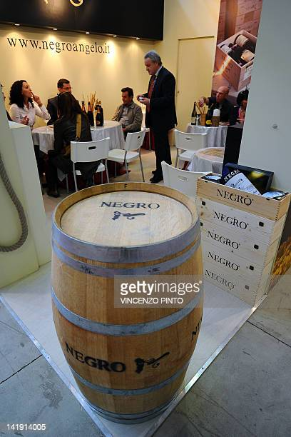 Abarrel of wine is displayed at the entrance of a producer from the Cuneo region' stand on March 25 2012 at the Vinitaly exposition in Verona The...
