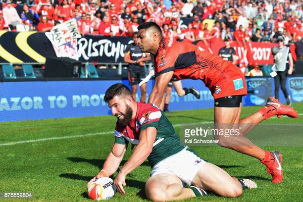 Abbas Miski of Lebanon dives over to score a try during the 2017 Rugby League World Cup Quarter Final match between Tonga and Lebanon at AMI Stadium...