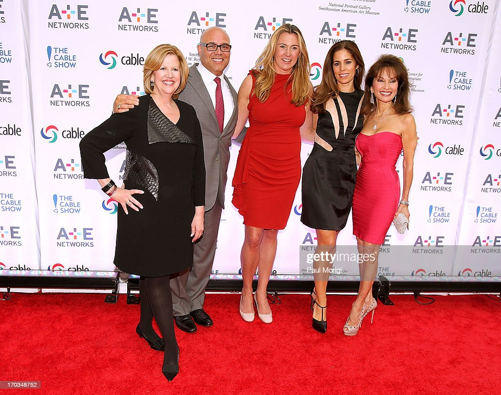 Abbe Raven, Chairman, A+E Networks and co-chair of The Cable Show 2013, Michael Powell, President and CEO, NCTA and co-chair of The Cable Show 2013, Nancy Dubuc, President and CEO, A+E Networks, and actresses Anna Ortiz and Susan Lucci pose for a photo at Smithsonian American Art Museum & National Portrait Gallery on June 11, 2013 in Washington, DC.