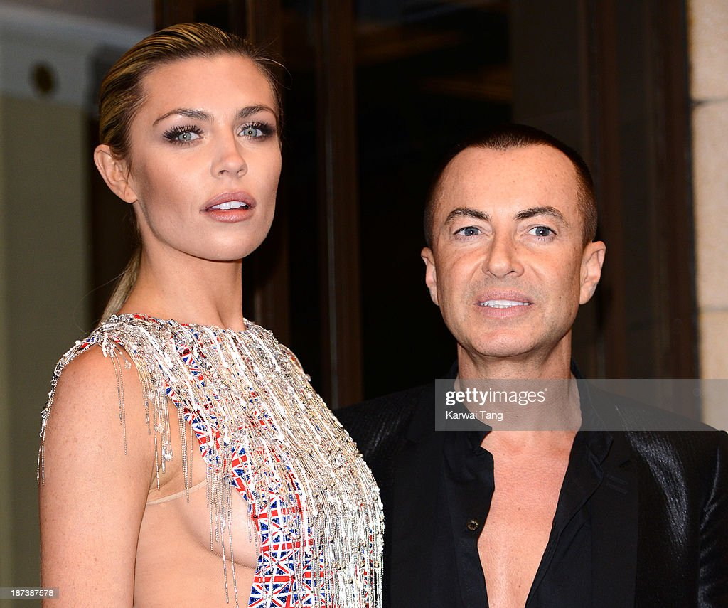 Abbey Clancy and Julien Macdonald attend a Fashion for the Brave photocall in support of the British Forces at war at The Dorchester on November 8, 2013 in London, England.