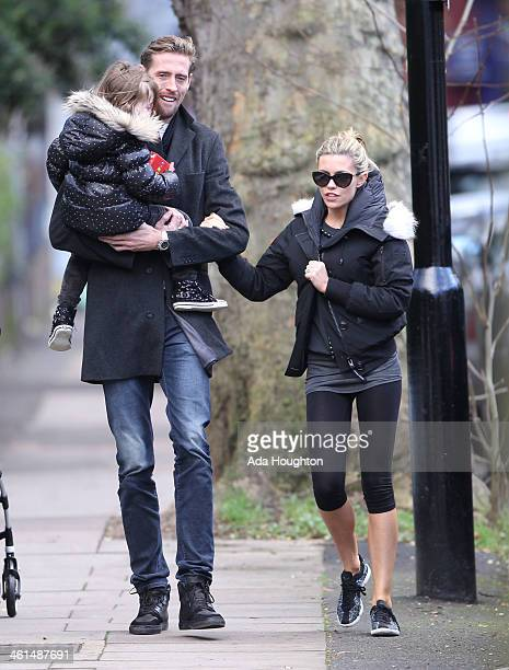 Abbey Clancy and Peret Crouch and their daughter are pictured out in North London on January 9 2014 in London England