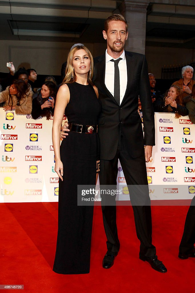 Abbey Clancy and <a gi-track='captionPersonalityLinkClicked' href=/galleries/search?phrase=Peter+Crouch&family=editorial&specificpeople=210764 ng-click='$event.stopPropagation()'>Peter Crouch</a> attend the Pride of Britain awards at The Grosvenor House Hotel on October 6, 2014 in London, England.