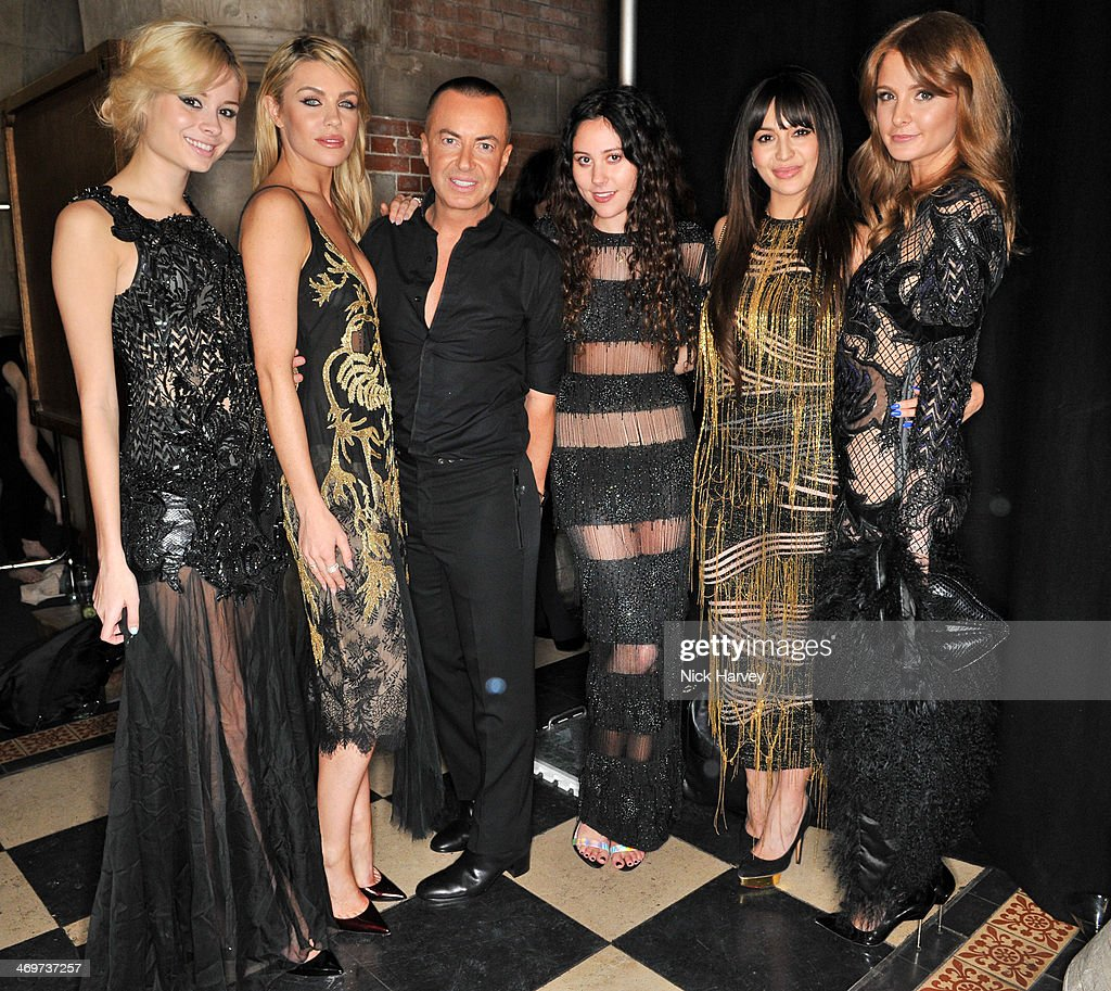 Abbey Clancy, Nina Nesbitt, Julien Macdonald, Eliza Doolittle, Zara Martin and Millie Mackintosh attend the Julien Macdonald show at London Fashion Week AW14 at Royal Courts of Justice, Strand on February 15, 2014 in London, England.