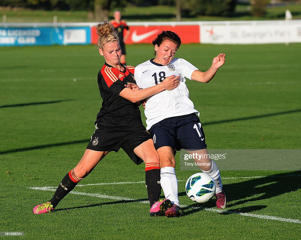 Abbey Joice of England tackled by Janina Meissner of Germany during the Women's International Friendly match between England Under 19 Women and Germany Under 19 Women at St George's Park on September 22, 2013 in Burton upon Trent, England.