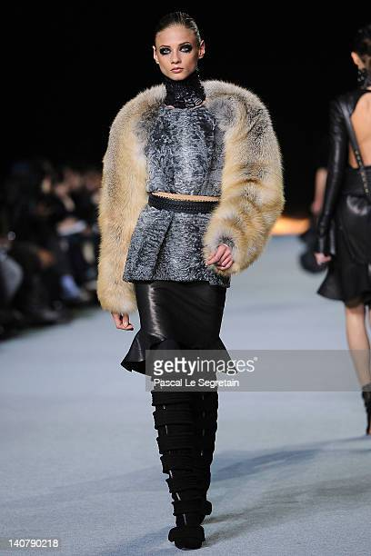 Abbey Lee Kershaw walks the runway during the Kanye West ReadyToWear Fall/Winter 2012 show as part of Paris Fashion Week at Halle Freyssinet on March...