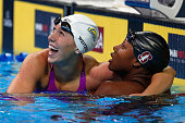 Abbey Weitzeil of the United States celebrates with Simone Manuel of the United States after finishing first in the final heat for the Women's 100...
