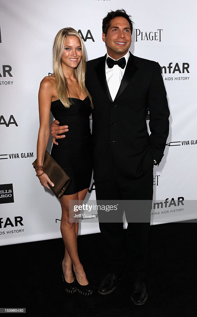 Abbey Wilson and <a gi-track='captionPersonalityLinkClicked' href=/galleries/search?phrase=Joe+Francis&family=editorial&specificpeople=544470 ng-click='$event.stopPropagation()'>Joe Francis</a> arrive at amfAR's Inspiration Gala at Milk Studios on October 11, 2012 in Los Angeles, California.
