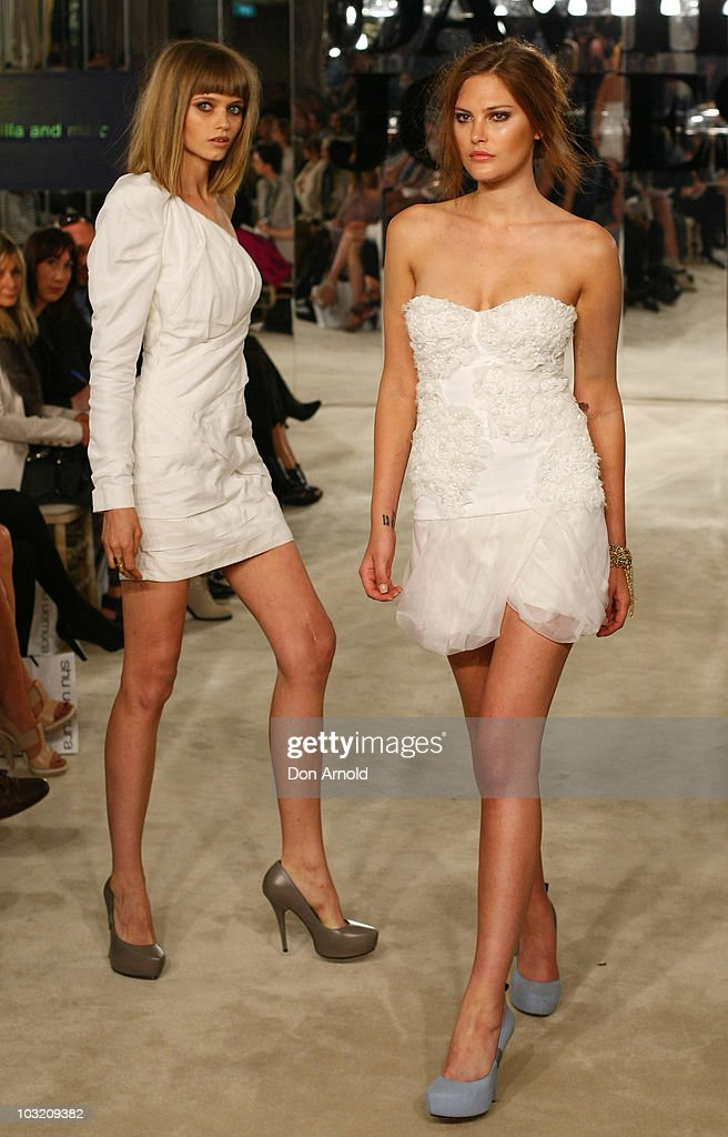 Abbey-Lee Kershaw and <a gi-track='captionPersonalityLinkClicked' href=/galleries/search?phrase=Catherine+McNeil&family=editorial&specificpeople=737640 ng-click='$event.stopPropagation()'>Catherine McNeil</a> wear designs by camilla and marc on the catwalk during the David Jones Spring/Summer 2010 Season Launch at David Jones Elizabeth Street Store on August 3, 2010 in Sydney, Australia.