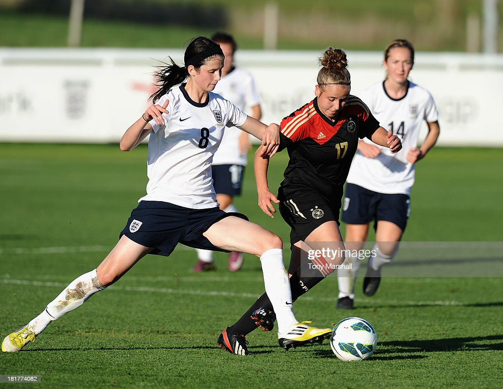 Abbey-Leigh Stringer of England tackles Vivien Beil of Germany during the Women's International Friendly match between England Under 19 Women and Germany Under 19 Women at St George's Park on September 22, 2013 in Burton upon Trent, England.