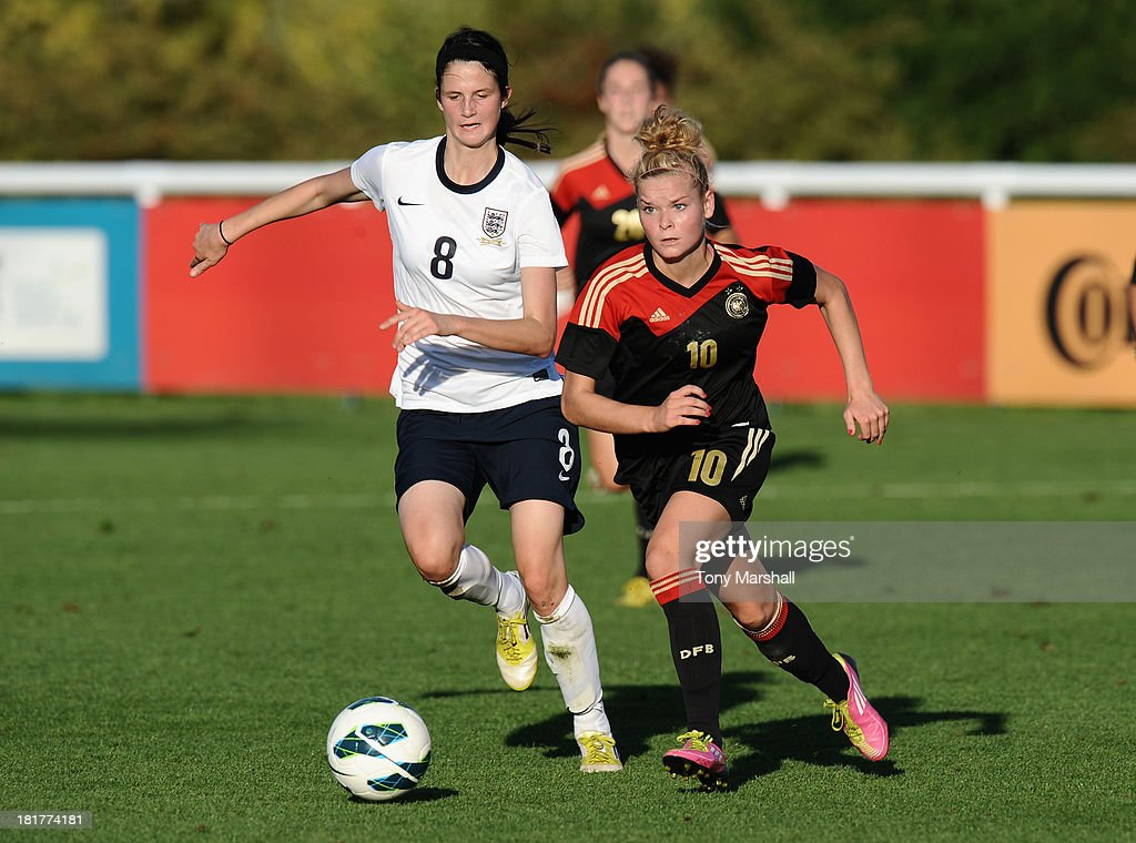 Abbey-Leigh Stringer of England with Janina Meissner of Germany during the Women's International Friendly match between England Under 19 Women and Germany Under 19 Women at St George's Park on September 22, 2013 in Burton upon Trent, England.