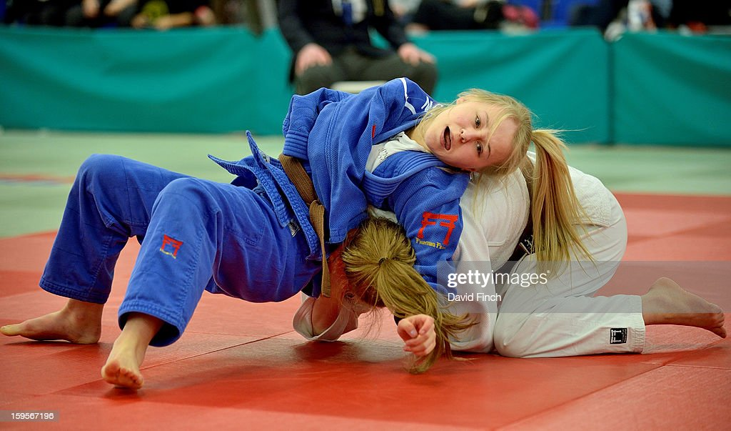 Abbi Blackie of Sportif JC (white) defeated Francesca Marston of Samurai by 2 wazaris from a throw and a hold on her way to the Cadet Girls Under 52kgs gold medal. Here, Marston fights back attempting to strangle Blackie into submission with a strangle during the British Cadet and Pre-Cadet Judo Championships on day 2, Sunday, January 13, 2013 at the English Institute of Sport, Sheffield, England, UK.