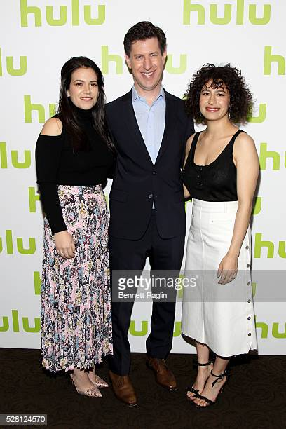 Abbi Jacobson and Ilana Glazer of Broad City pose with Hulu SVP Head of Content Craig Erwich at the 2016 Hulu Upftont on May 04 2016 in New York New...