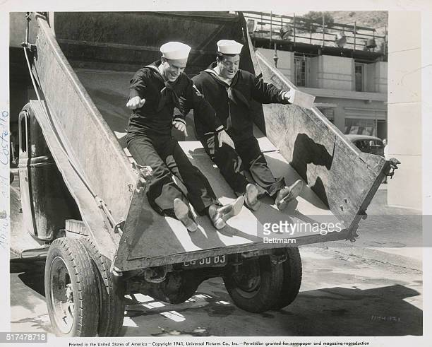Abbott And Costello And Dick Powell In The Navy Smoky and Pomeroy make a threepoint landing in the San Diego business district en route to deliver...