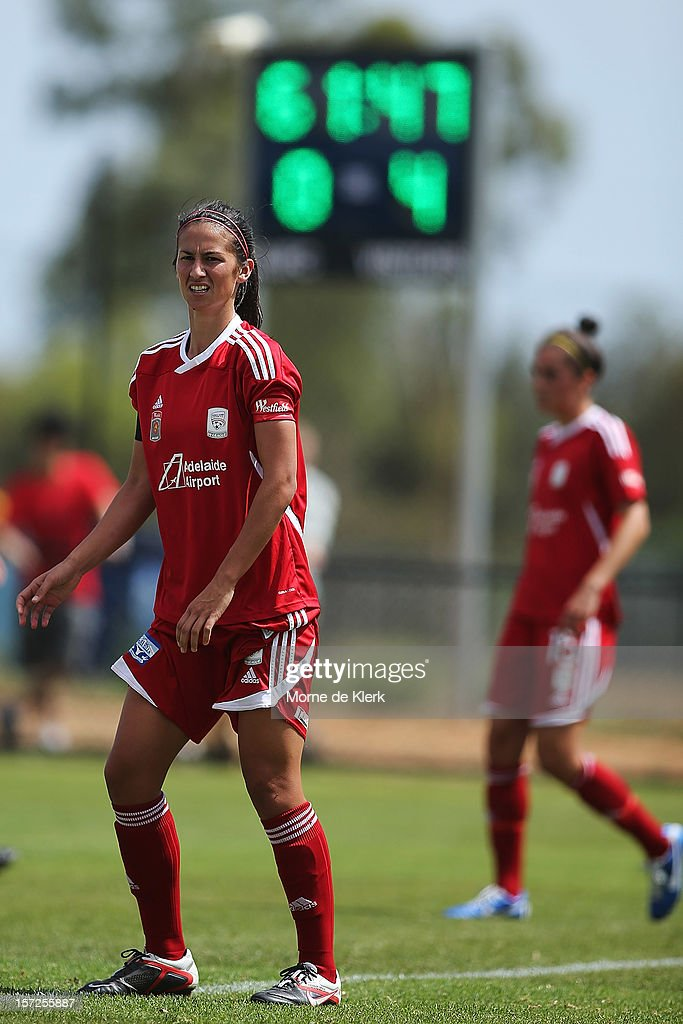 Abby Erceg (L) of Adelaide stands in defence as the scoreboard visible in the background during the round seven W-League match between Adelaide United and the Melbourne Victory at Burton Park on December 1, 2012 in Adelaide, Australia.