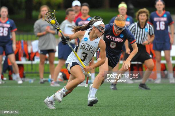 Abby Flager of College of New Jersey drives down the field defended by Maggie Welsh of Gettysburg College during the Division III Women's Lacrosse...