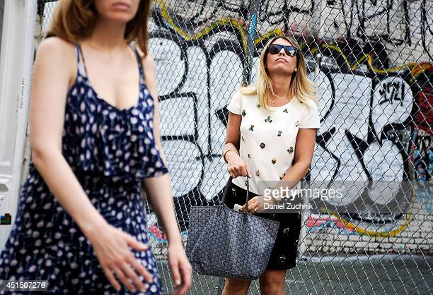 Abby is seen around Soho wearing a Cynthia Steffe dress Goyard bag and Ray Ban sunglasses on June 30 2014 in New York City