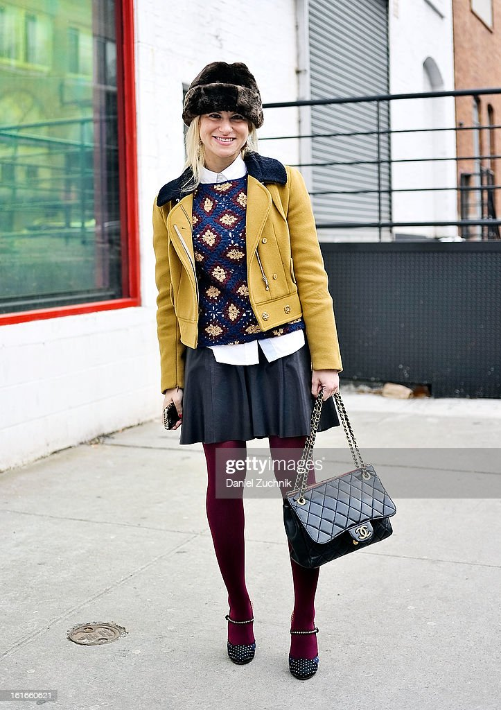 Abby Kalicka, senior market editor at Seventeen Magazine, seen outside the Joie presentation wearing a Carbon jacket, Elizabeth and James sweater, Jonathan Simkhai skirt, Tabitha Simmons Shoes, Chanel bag and a vintage hat on February 13, 2013 in New York City.