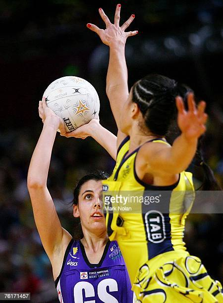 Abby Sarhent of the Phoenix shoots for goal as Mo'onia Gerrard of the Swifts defends during the Commonwealth Bank Trophy Final match between the...