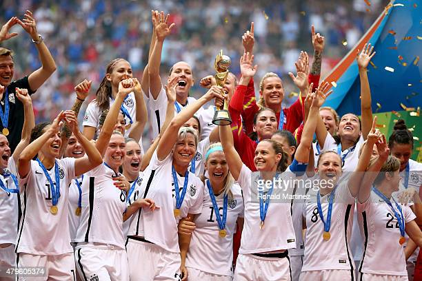 Abby Wambach and Christie Rampone of the United States of America hold the World Cup Trophy after their 52 win over Japan in the FIFA Women's World...