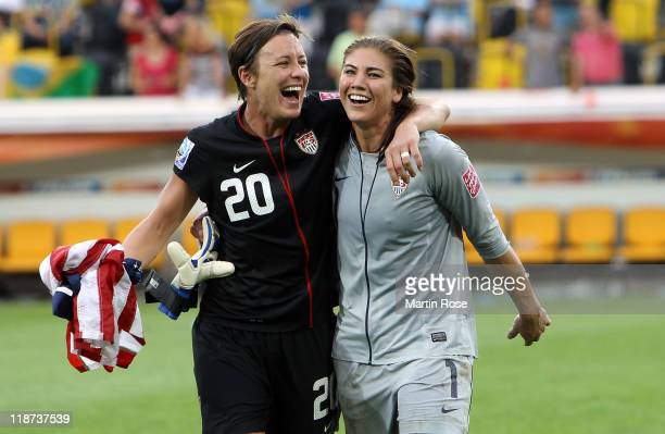 Abby Wambach and Hope Solo goalkeeper of USA celebrate their victory after penalty shoot out during the FIFA Women's World Cup 2011 Quarter Final...