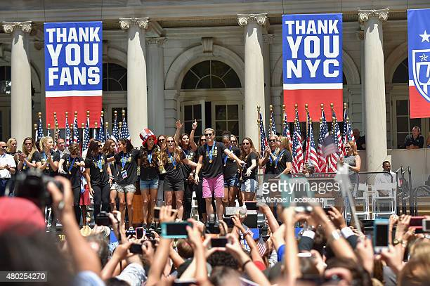 Abby Wambach and the World Cup Champions US Women's Soccer National Team celebrate at a City Hall ceremony following a New York City Ticker Tape...