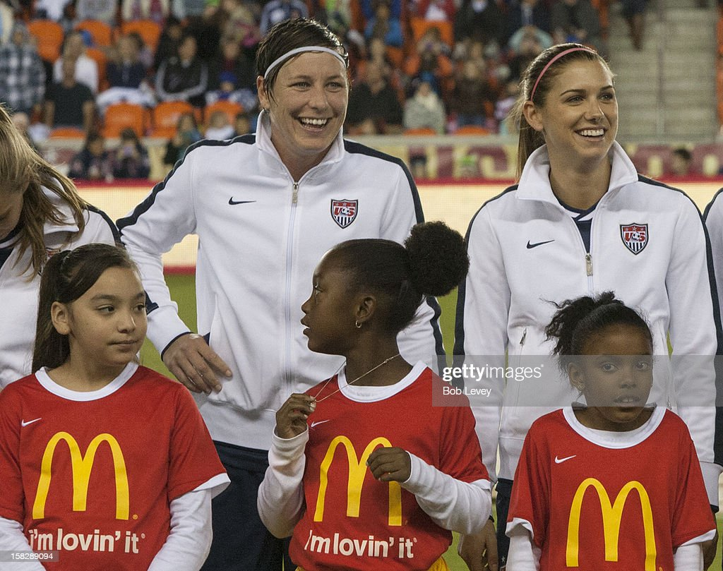 <a gi-track='captionPersonalityLinkClicked' href=/galleries/search?phrase=Abby+Wambach&family=editorial&specificpeople=162757 ng-click='$event.stopPropagation()'>Abby Wambach</a>, left, and <a gi-track='captionPersonalityLinkClicked' href=/galleries/search?phrase=Alex+Morgan+-+Soccer+Player&family=editorial&specificpeople=1057310 ng-click='$event.stopPropagation()'>Alex Morgan</a> during pre-game ceremonies at BBVA Compass Stadium on December 12, 2012 in Houston, Texas. USA won 4-0.