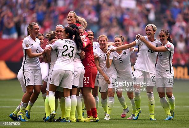 Abby Wambach of the United States celebrates with teammates in the 52 victory against Japan in the FIFA Women's World Cup Canada 2015 Final at BC...