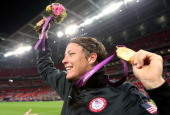Abby Wambach of the United States celebrates with the gold medal after defeating Japan by a score of 21 to win the Women's Football gold medal match...