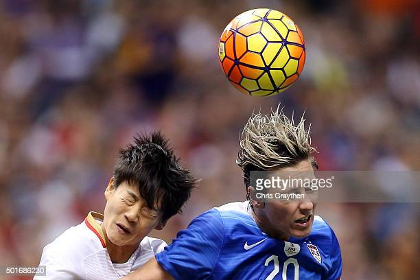 Abby Wambach of the United States fights for a ball with Li Dongna of China at the MercedesBenz Superdome on December 16 2015 in New Orleans Louisiana